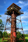 Old Artillery Tower at Fort Mott in New Jersey. Old artillery aiming control help and military gun range finder rusty abandoned steel tower at historic Fort Mott Royalty Free Stock Photography