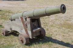 The old artillery weapon is a cannon. The old iron cannon. Artillery weapons. Fire position. The purpose of the attack. Shoot the target. Weapons in war Stock Photo