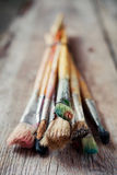 Old artist paintbrushes on rustic wooden table Stock Photography