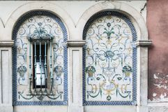 Old, artistic and decorative tiles. Placed on walls stock images