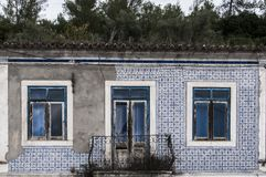 Old, artistic and decorative tiles. Old tiled building coverded with artistic and decorative tiles stock photography