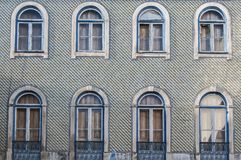 Old, artistic and decorative tiles. Old tiled building coverded with artistic and decorative tiles royalty free stock images