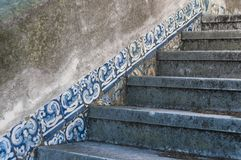 Old, artistic and decorative tiles. In a stairs stock photography