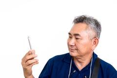 Old Asain man look at mobile phone Royalty Free Stock Photo