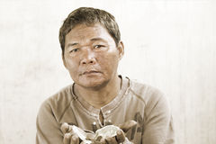 Old asian beggar man Royalty Free Stock Photos