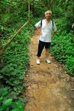 Old Asian hiker on mountain trail Stock Photos
