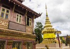 Old asian house and gold pagoda architecture Royalty Free Stock Image