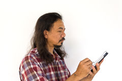 Old asian man using tablet-pc Royalty Free Stock Photography