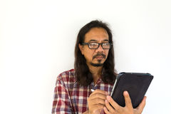 Old asian man using tablet-pc Royalty Free Stock Image