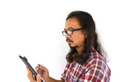 Old asian man using tablet-pc Royalty Free Stock Photos