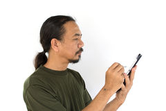 Old asian man using tablet-pc Royalty Free Stock Photo