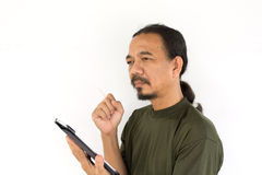 Old asian man using tablet-pc Stock Photography