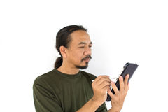 Old asian man using tablet-pc on Royalty Free Stock Photography