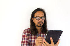 Old asian man using tablet-pc on white background Stock Photo