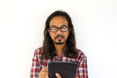 Old asian man using tablet-pc on white background Stock Photos