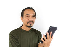 Old asian man using tablet-pc on white background Royalty Free Stock Photography