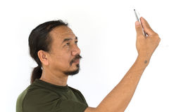 Old asian man using tablet-pc on white background Royalty Free Stock Photo