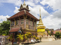 Old asian pink house and gold pagoda Royalty Free Stock Photos