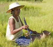 Old Asian woman with opium pipe Royalty Free Stock Photo