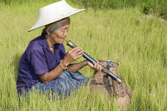 Old Asian woman with opium pipe Stock Photo