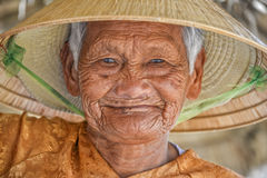 Old asian woman with conical Royalty Free Stock Images
