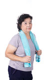 Old Asian woman smiling after workout, holding towel around neck Stock Images