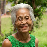 Old asian women. Portrait of grey haired person with wrinkled face Royalty Free Stock Photo