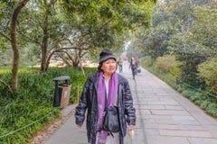Old asian women traveler walk in the xihu lakewest lake park royalty free stock photos