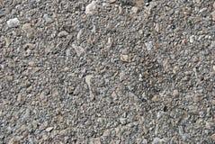 Old asphalt. Fragment of old asphalt road close up Royalty Free Stock Image