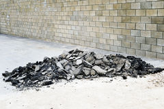 Old asphalt pieces stacked in a pile on the sidewalk Royalty Free Stock Photos