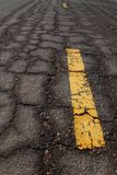 Old Asphalt road cracked pattern. With old traffic marking Stock Images