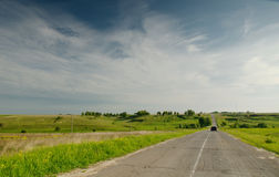 The old asphalt road in the field Royalty Free Stock Photos