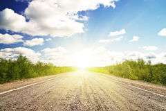 Old Asphalt Road In Green Sunset Meadow Royalty Free Stock Photography