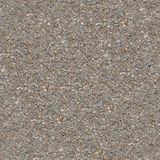 Old Asphalt Road. Seamless Tileable Texture. Seamless Tileable Texture of Old Asphalt Road with Protruding Stones Stock Image