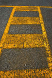 Old Asphalt and Yellow Lines Royalty Free Stock Photography