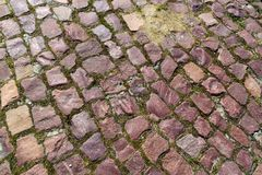 Old asymmetric granite brick pavement Royalty Free Stock Photo