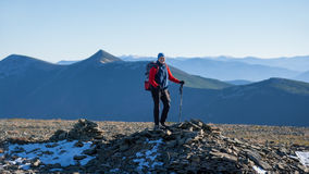 Old athletic woman backpacker on the top of the mountain Royalty Free Stock Photo
