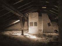 An old attic under a roof. The forgotten, light image of children games - an attic. sepia execution Stock Photos