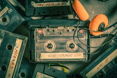 Old audio cassette with headphones and walkman Royalty Free Stock Photo