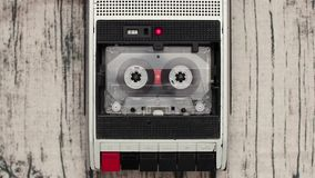 Old audio cassette reel playing in the tape recorder. Tape Reels Playing in the Tape Recorder stock video