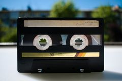 Old audio cassette of the 90s. The memory of the past. royalty free stock images