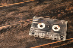 Old audio cassette on wooden background. music abstract. Stock Image
