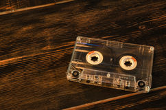 Old audio cassette on wooden background. music abstract. Royalty Free Stock Image
