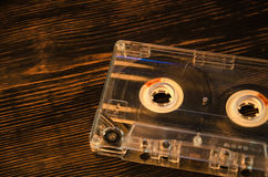 Old audio cassette on wooden background. music abstract. Stock Photography