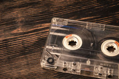 Old audio cassette on wooden background. music abstract. Royalty Free Stock Photos