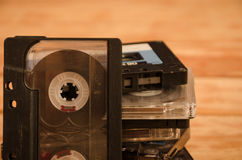 Old audio cassettes on wooden background. music abstract. Royalty Free Stock Photography
