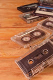 Old audio cassettes on wooden background. music abstract. Royalty Free Stock Images
