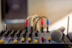 The old audio mixer and microphone. In school Stock Images
