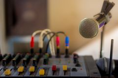 The old audio mixer and microphone. In school Stock Image