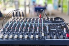 An Old Audio Mixing Board Sliders. And old Equalizer mixer controller with knobs and sliders for mini event Royalty Free Stock Images